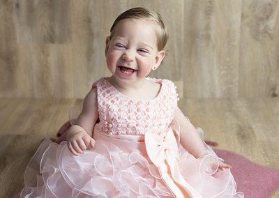 sittershoot fotoshoot roze jurkje meisje 6 tot 11 maanden zelf zitten diana schouten fotografie na newborn en voor cake smash